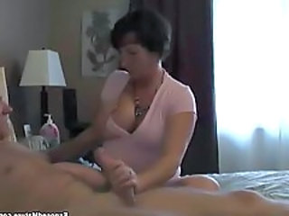 Busty mature jerking hard cock