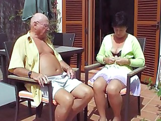 Videos from: tubewolf | Mature takes her top off under the sun