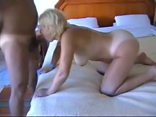 Mature blonde fucked doggy...