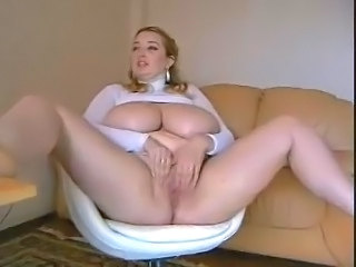 Busty  and masturbates