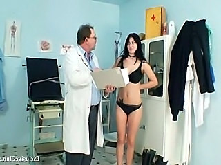 Busty brunette girl Adriana visiting her gyno doctor.She is speculum...