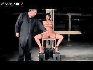 Busty Girl Moutgag Tied To Chair Vibrator Between Legs Neck Tortured With Weight In The Dungeon