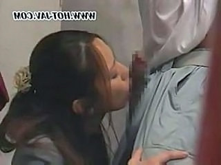 Japanese girl sucks and fucks this guy's cock at a job location