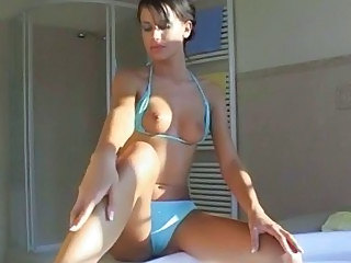 Young brunette chick masturbates outdoors