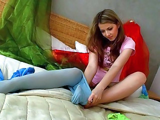 Videos from: sunporno | Lovely teen blonde tries on her new pantyhose