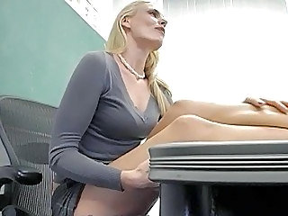 Hot blonde teacher shows off her massive boobs and masturbates