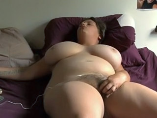 Amazing busty BBW masturbates on...
