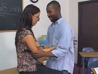 Female Brunette White Teacher With Male Black Studen...