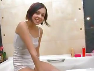 Young Foamed Teen Washing In A B...
