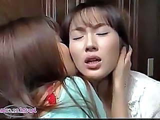 2 Asian Girls Kissing Passionately Patting While Standing At The Door In The...