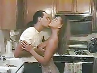 hot couple enjoying their sex in kitchen