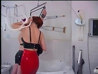 Femdom leads her male submissive to bathroom