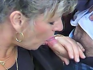 A hot French mature meets two horny guys in a park