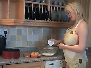 Busty Babe In Kitchen