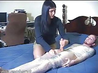 Videos from: tubewolf | Dude in plastic wrap stroked by clothed girl tubes