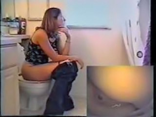 Nice girl takes a shit on the toilet
