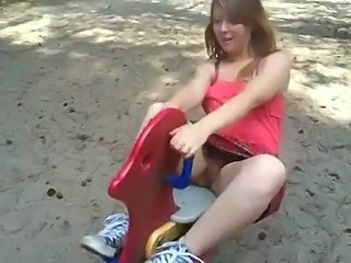 Young Girl riding a toy and shows her pussy...