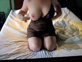 girl stripping and showing her huge tits in front of cam