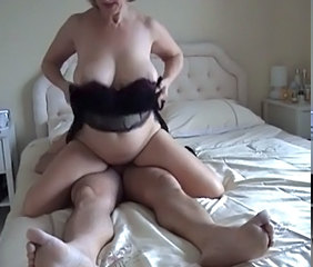 mature with big tits on her man