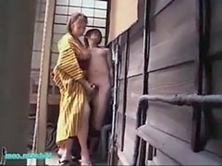 Busty Asian Girl In Kimono Giving Handjob Sucking Guy Cock Outside On The Balcony