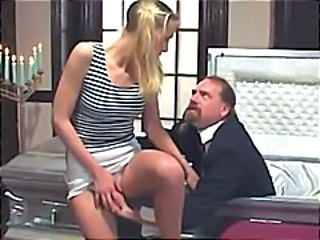 Blonde in pigtails gets it in all her holes over the casket