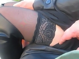 Touching her stockings and tits outside