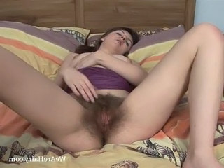 Helen screams with beads deep in her hairy pussy