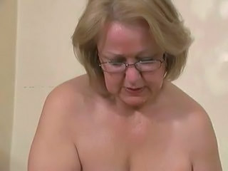 Horny older wife jerking young student. Amateur