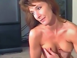Sexy Redhead MILF concerning White Women's knickers Playing concerning Big Tits