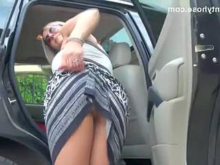 Stunning blonde milf in pantyhose shows her undies in car