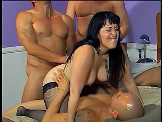 MILF in nylons takes on 3 big cocks