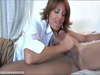 Brunette milf with amazing boobies sucks and licks young sti...