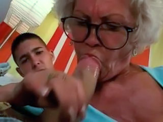 Granny In Glasses Fucks The Boy
