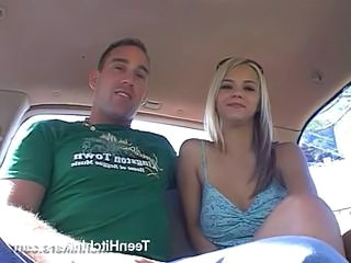 Tattooed teen hitchhiker sucks a big cock in the car