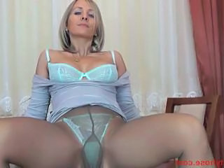 Tight ass blonde cougar in pantyhose fingers her nookie over...