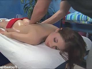 Cute brunette enjoying hot massage
