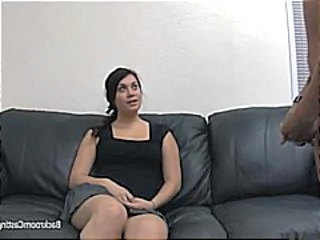 Ladies on casting couch play with each other and a hard cock