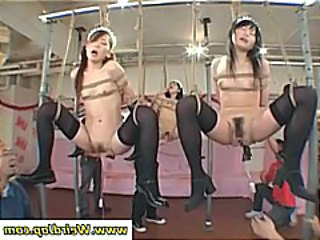 Tied up Japanese maids are getting their pussies poked and prodded