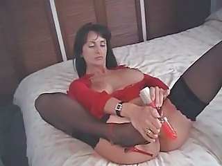 British MILF fucks herself with a pair of high