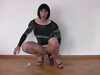 Crossdresser riding a dildo