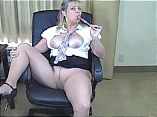 Blonde granny shows off her big boobs and then masturbates