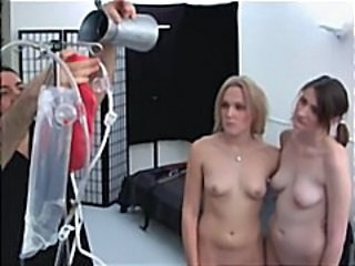 Two Gals Are Possessions Tied Up And Toyed By A Fuck Machine Nailing Them
