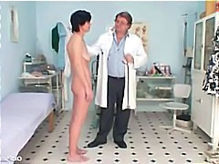 Skinny mature brunette visits the nasty old gyno doctor and gets a wide open pussy exam