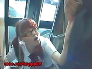 Japanese schoolgirl gets facial on the bus.