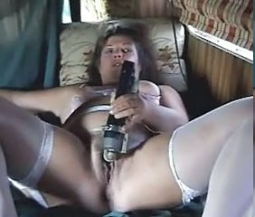 Mature slut using her toys to masturbate