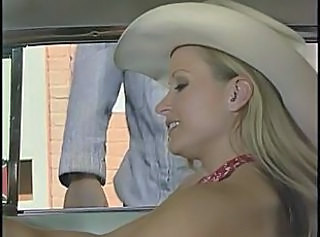 Horny ranch couple in action outdoors