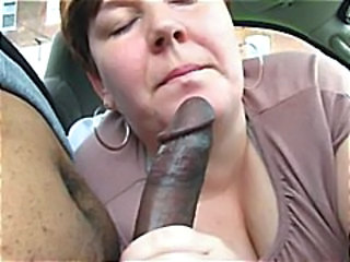 Chubby mature gives this black guy a nice blowjob in POV style