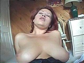 Busty mature redhead gets a big cock to suck and fuck for cumshot