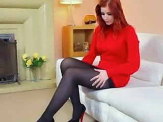 Redhead in nylons stripping in red-hot shoes