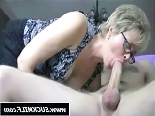 Blonde MILF with glasses sucks his hard cock for some juice